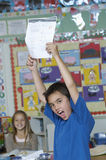 Boy Presenting His Test Result Royalty Free Stock Photos