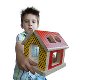 Boy presenting wood colorful house toy Royalty Free Stock Photography