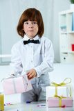 Boy with presents Stock Image