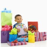 Boy with presents. Royalty Free Stock Photos