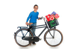 Boy with presents for Mothers-day. A teenage boy with a bike, full of presents for mothers-day, on a white background stock photos