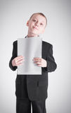 Boy presses the stack of paper Stock Photography
