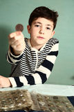 Boy preteen numismatic collector. Show his coin collection Royalty Free Stock Photos