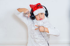 Boy pretending he is a Bad Santa Royalty Free Stock Image