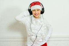 Boy pretending he is a Bad Santa Royalty Free Stock Images