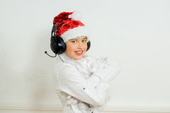 Boy pretending he is a Bad Santa Stock Images