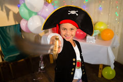 Boy pretending to be as pirate during birthday party. At home Royalty Free Stock Photography