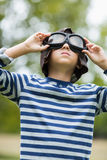 Boy pretending to be an aviation pilot. In park Stock Photo