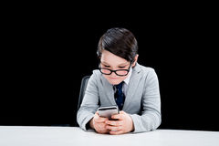 Boy pretending to be businessman and using smartphone Stock Image