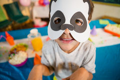 Boy pretending to be a dog during birthday party. At home Royalty Free Stock Images