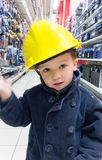 Boy pretending to be an engineer and shopping. In a mechanical shop Royalty Free Stock Photos