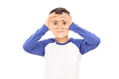 Boy pretending to be looking through binoculars Royalty Free Stock Photo