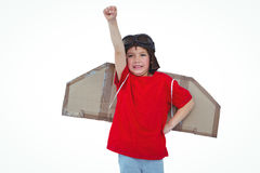 Boy pretending to be a pilot. Boy raising fist pretending to be a pilot on white screen Royalty Free Stock Image