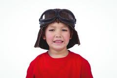 Boy pretending to be pilot. On white screen Stock Photo