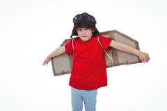 Boy pretending to be a pilot. On white screen Royalty Free Stock Photos