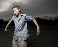 Boy pretending to be a scarecrow Royalty Free Stock Photos