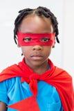 Boy pretending to be a superhero Stock Images