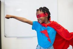 Boy pretending to be a superhero Royalty Free Stock Photography