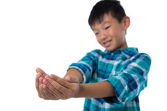 Boy pretending to hold invisible object Stock Photo