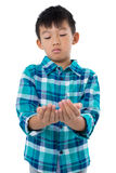 Boy pretending to hold invisible object Stock Photography
