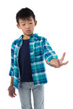 Boy pretending to hold invisible object Royalty Free Stock Photos