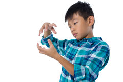 Boy pretending to hold invisible object Stock Image