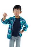Boy pretending to touch an invisible screen Stock Image