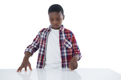 Boy pretending to touch an invisible screen Stock Images