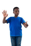 Boy pretending to touch an invisible screen Royalty Free Stock Photography