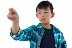 Boy pretending to touch an invisible screen Royalty Free Stock Photo