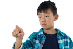 Boy pretending to touch an invisible screen Stock Photography