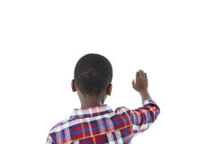 Boy pretending to touch an invisible screen against white background Royalty Free Stock Photo