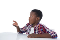 Boy pretending to work on an invisible object Stock Photography