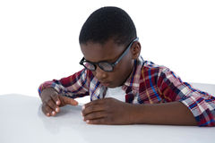 Boy pretending to work on an invisible object Royalty Free Stock Photos