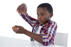 Boy pretending to work on an invisible object Stock Photo