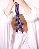 Boy Pretends to be Grown-up Angry with Necktie. Young Blond Boy Pretending to be Grown-Up Shows Emotion with Men's Tie.  Boy is wearing a man's white dress shirt Royalty Free Stock Photos