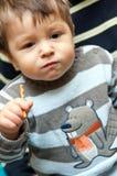 Boy with pretzel stick Royalty Free Stock Image