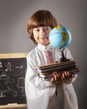 Boy primary school students with books Royalty Free Stock Photo