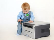 Boy with a printer Royalty Free Stock Photo