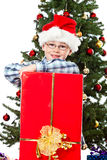 Boy prod of his big christmas gift Royalty Free Stock Photos