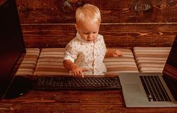 Boy programming on computer with multiple monitors and laptop on desk. Developing programming and coding technologies.  royalty free stock image
