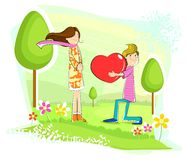 Boy proposing girl. With heart in park Royalty Free Stock Photography
