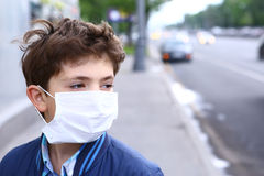 Boy in protection mask on the highway city royalty free stock photos