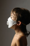 Boy in a protective mask Royalty Free Stock Photography