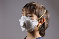 Boy in a protective mask Stock Photography