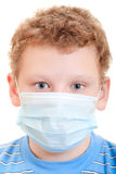 Boy in protective mask. A boy in a protective mask on a white background Royalty Free Stock Photos