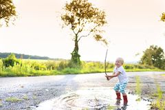Boy in a puddle Royalty Free Stock Photography