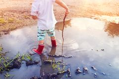Boy in a puddle Stock Image