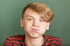 Boy puffing cheeks Stock Photo