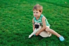 Boy and pug Stock Image